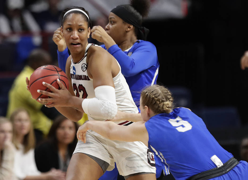 South Carolina's A'ja Wilson (22) looks to pass away from Buffalo's Katherine Ups (5) during the second half in a regional semifinal at the NCAA women's college basketball tournament Saturday, Mar ...