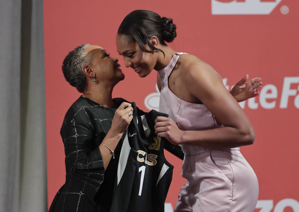 South Carolina's A'ja Wilson, right, is greeted by WNBA president Lisa Borders after being selected as the No. 1 overall pick in the WNBA basketball draft by the Las Vegas Aces, Thursday, April 12 ...