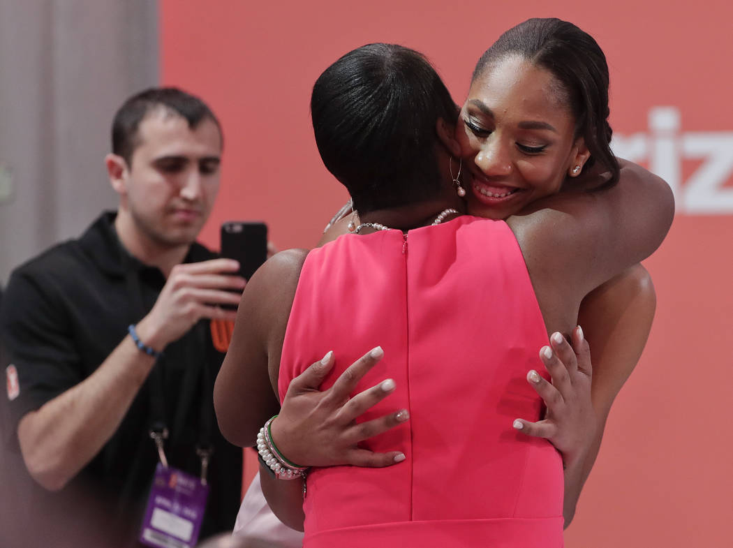 South Carolina's A'ja Wilson is congratulated by family after being selected as the No. 1 overall pick by the Las Vegas Aces in the WNBA basketball draft, Thursday, April 12, 2018, in New York. (A ...