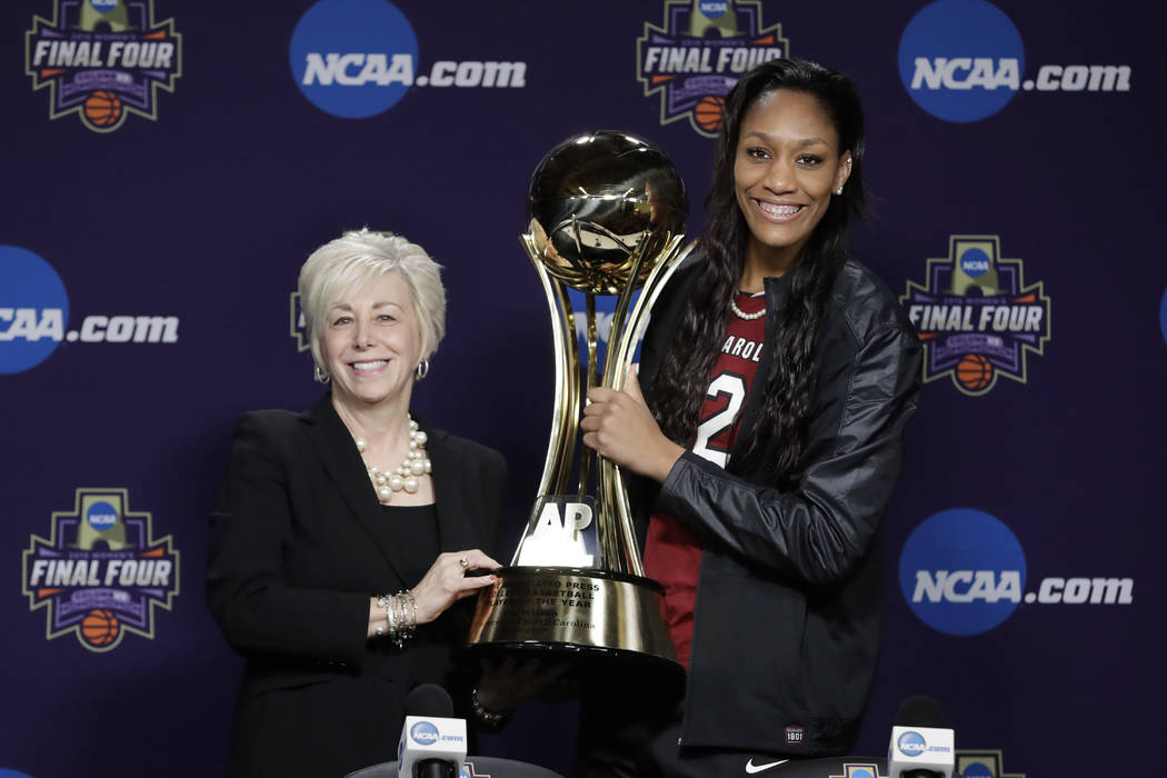 Associated Press' Eva Parziale presents the trophy to South Carolina's A'ja Wilson after Wilson was named AP's women's college basketball Player of the Year, at the NCAA women's Final Four college ...