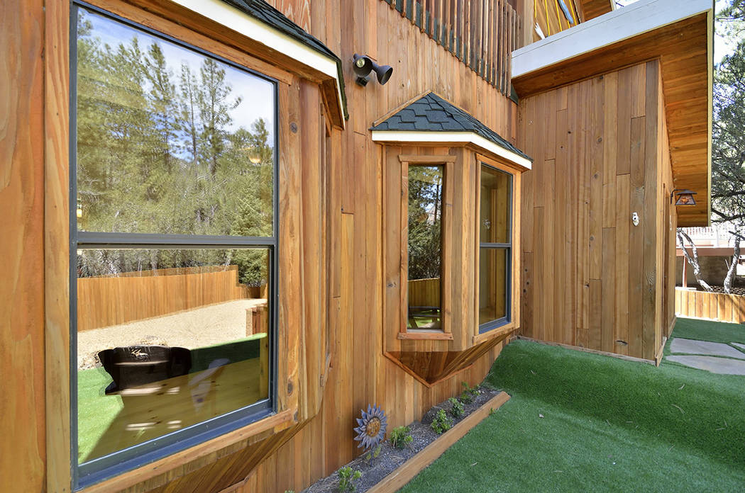 The exterior of the property is covered in a clear redwood siding. (Bill Hughes Real Estate Millions)