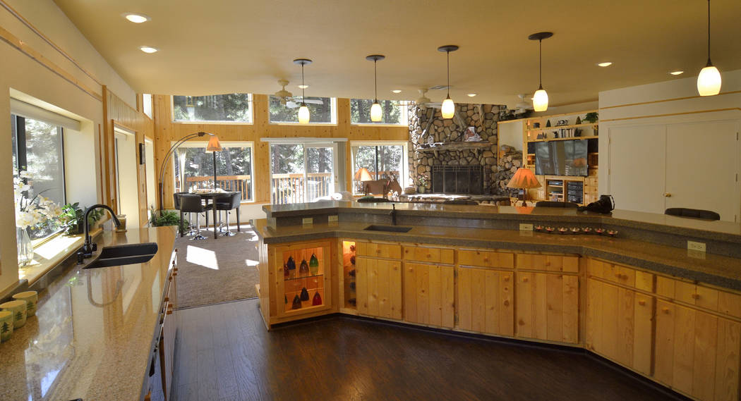 The kitchen's cabinets were made from knotty pine found in the original cabin on the site. (Bill Hughes Real Estate Millions)