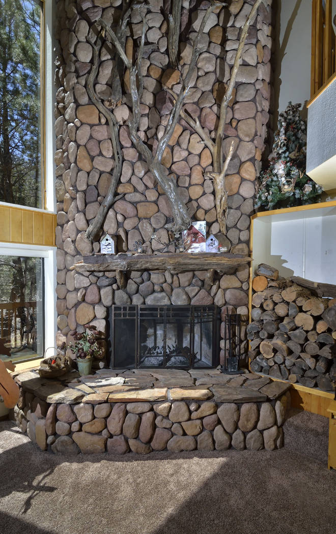 The massive fireplace is a focal point of the home. (Bill Hughes Real Estate Millions)