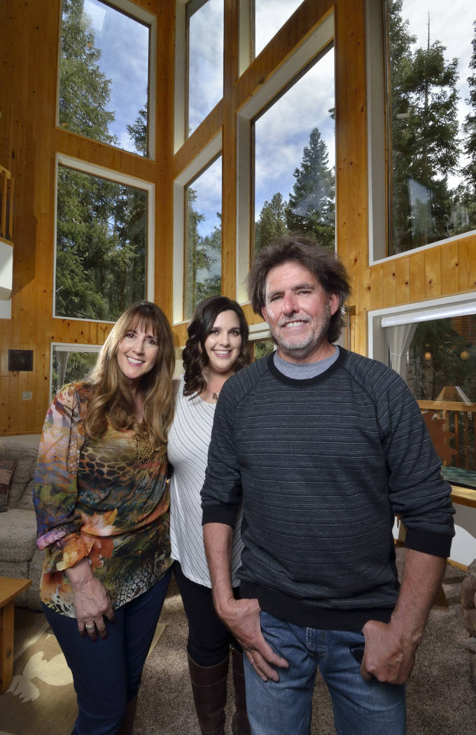 Angie, left, and Garry Tomashowski, right, are shown with their daughter, Katie Corr, at their home at 323 Mont Blanc Way on Mount Charleston. (Bill Hughes Real Estate Millions)