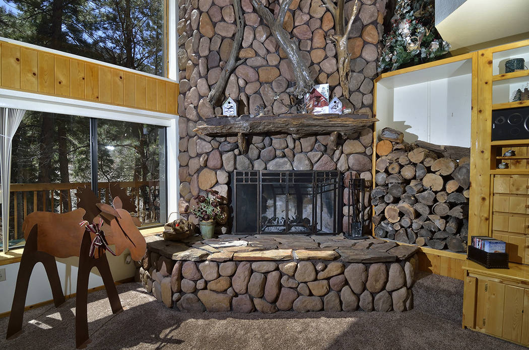 The fireplace is on the first floor. (Bill Hughes Real Estate Millions)