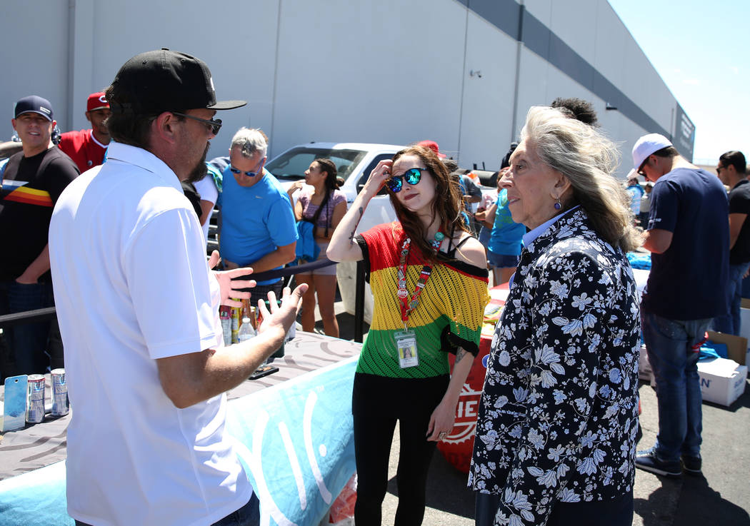 U.S. Rep. Dina Titus, D-Nev., right, talks to marijuana products venders, Daniel Bondch, left, and Kayleigh Shea as Titus hosts a voter registration drive outside Reef Dispensaries at 3400 W. Ave. ...