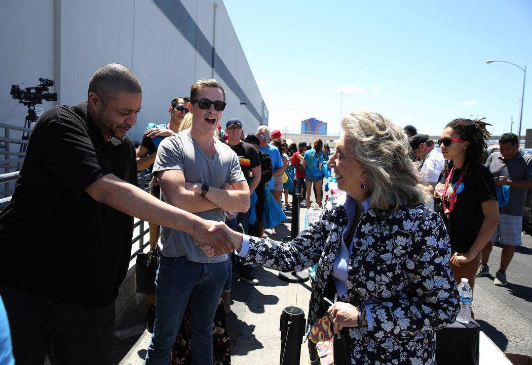 David, left, who declined to give his last name, shakes hands with U.S. Rep. Dina Titus, D-Nev., as Titus hosts a voter registration drive outside Reef Dispensaries at 3400 W. Ave., on Friday, Apr ...