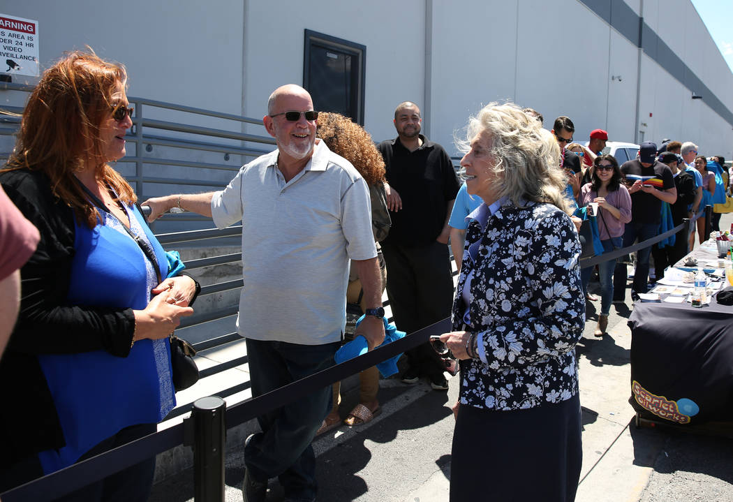 U.S. Rep. Dina Titus, D-Nev., right, talks to customers, who declined to give their names, as Titus hosts a voter registration drive outside Reef Dispensaries at 3400 W. Ave., on Friday, April 20, ...