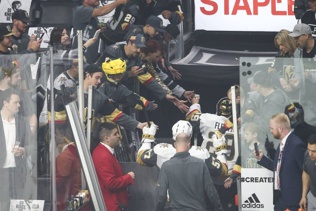 Golden Knights left wing David Perron (57) and goaltender Marc-Andre Fleury (29) leave the ice rink after warming up before taking on the Los Angeles Kings in Game 4 of an NHL hockey first-round p ...