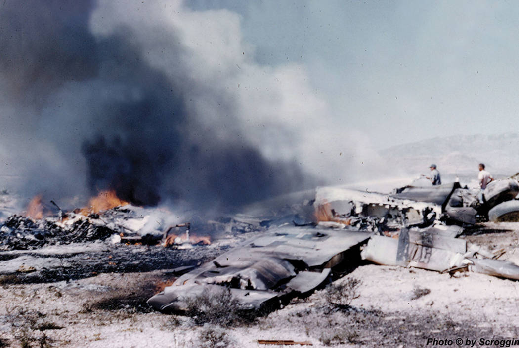 The wreckage of a United Airlines DC-7 smolders in the desert southwest of Las Vegas after a midair collision and crash that killed 49 people on April 21, 1958. Courtesy of Doug Scroggins