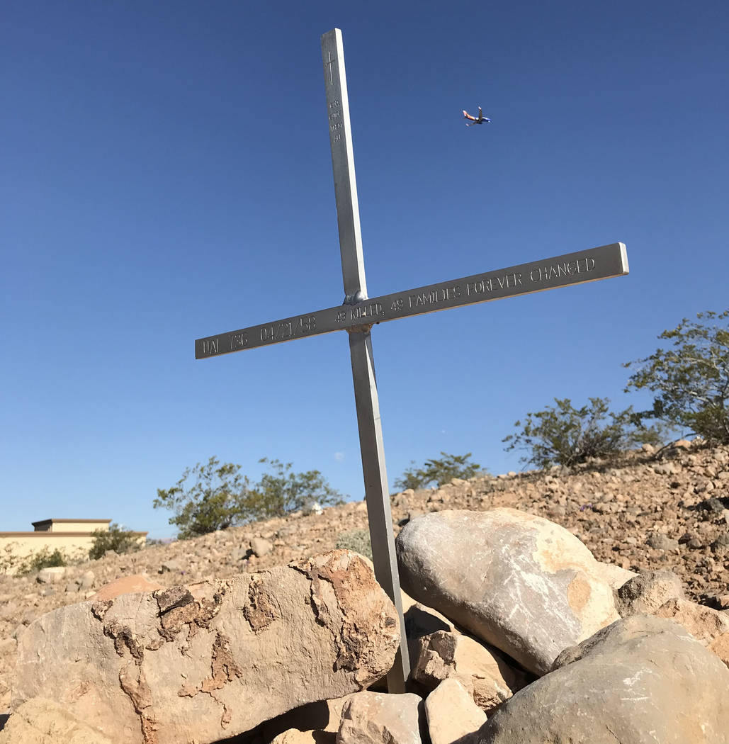 A Southwest Airlines jetliner flies past an engraved cross Friday marking the site of an April 21, 1958, crash that still ranks as the worst air disaster in Las Vegas history. Henry Brean Las Vega ...