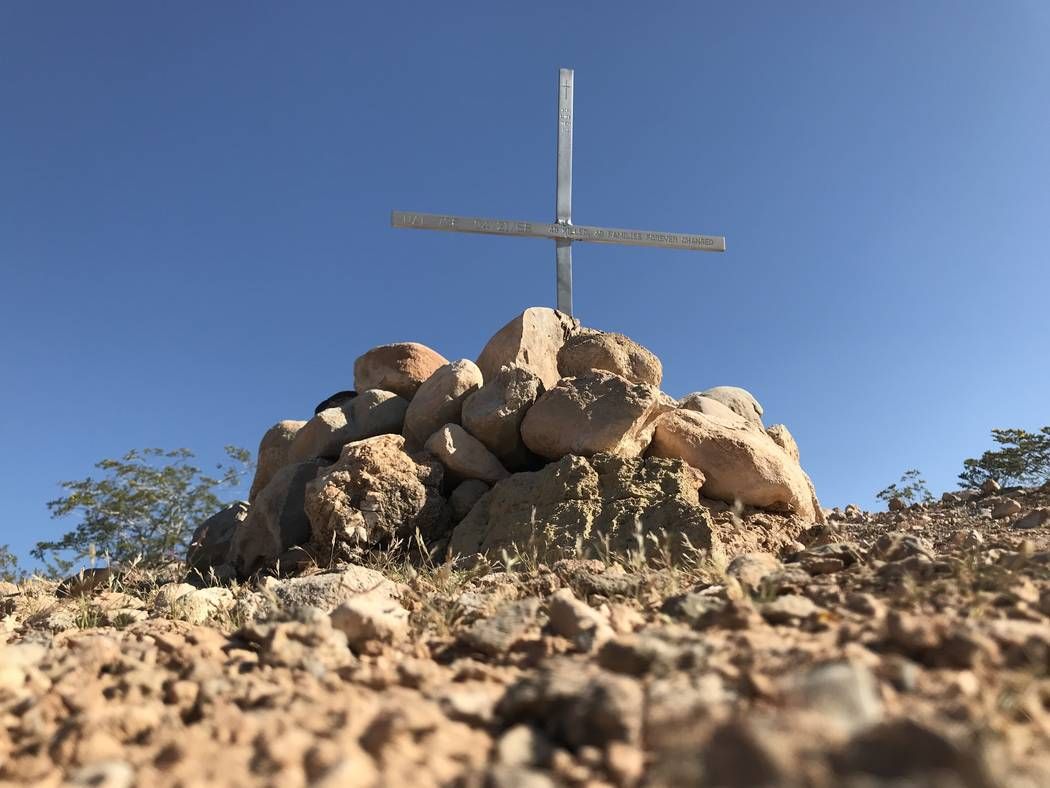 An engraved cross marks the site Friday of an April 21, 1958, crash that still ranks as the worst air disaster in Las Vegas history. Henry Brean Las Vegas Review-Journal