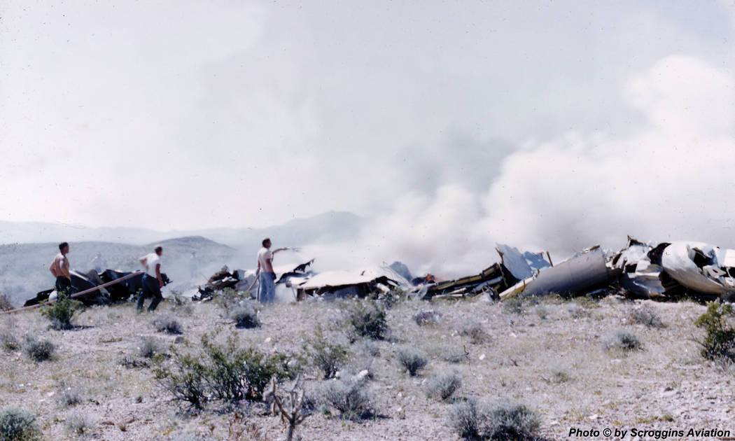 The wreckage of a United Airlines DC-7 smolders in the desert southwest of Las Vegas after a midair collision and crash that killed 49 people on April 21, 1958. Provided by Doug Scroggins