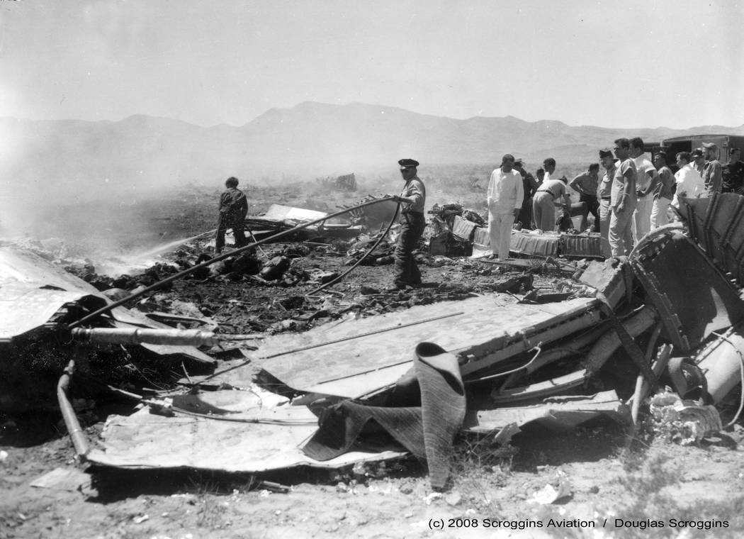 Rescue workers comb the wreckage of United Air Lines flight 736 on April 21, 1958. The crash killed 49 people after it collided with an Air Force jet out of Nellis Air Force Base. Las Vegas Review ...