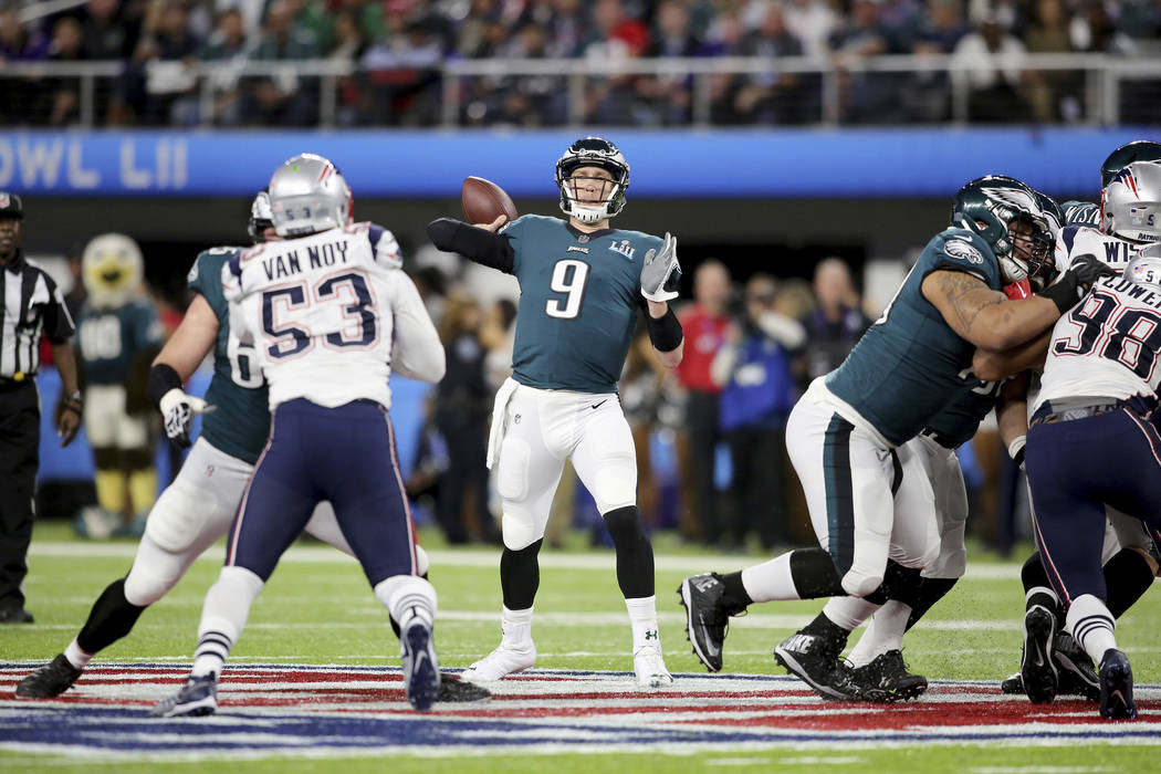 Philadelphia Eagles quarterback Nick Foles in action against the New England Patriots at Super Bowl 52 on Sunday, February 4, 2018 in Minneapolis. Philadelphia won the game 41-33.(AP Photo/Gregory ...
