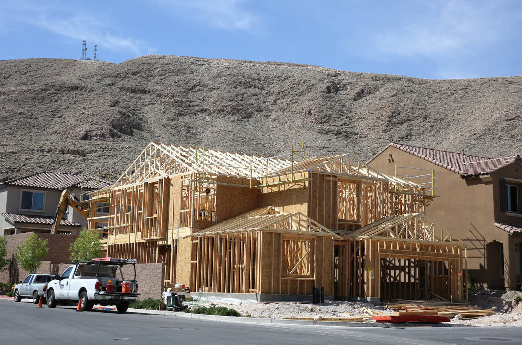 New homes under construction at the Cove at Southern Highlands and St. Rose parkways on Wednesday, April 18, 2018, in Las Vegas. Bizuayehu Tesfaye/Las Vegas Review-Journal @bizutesfaye
