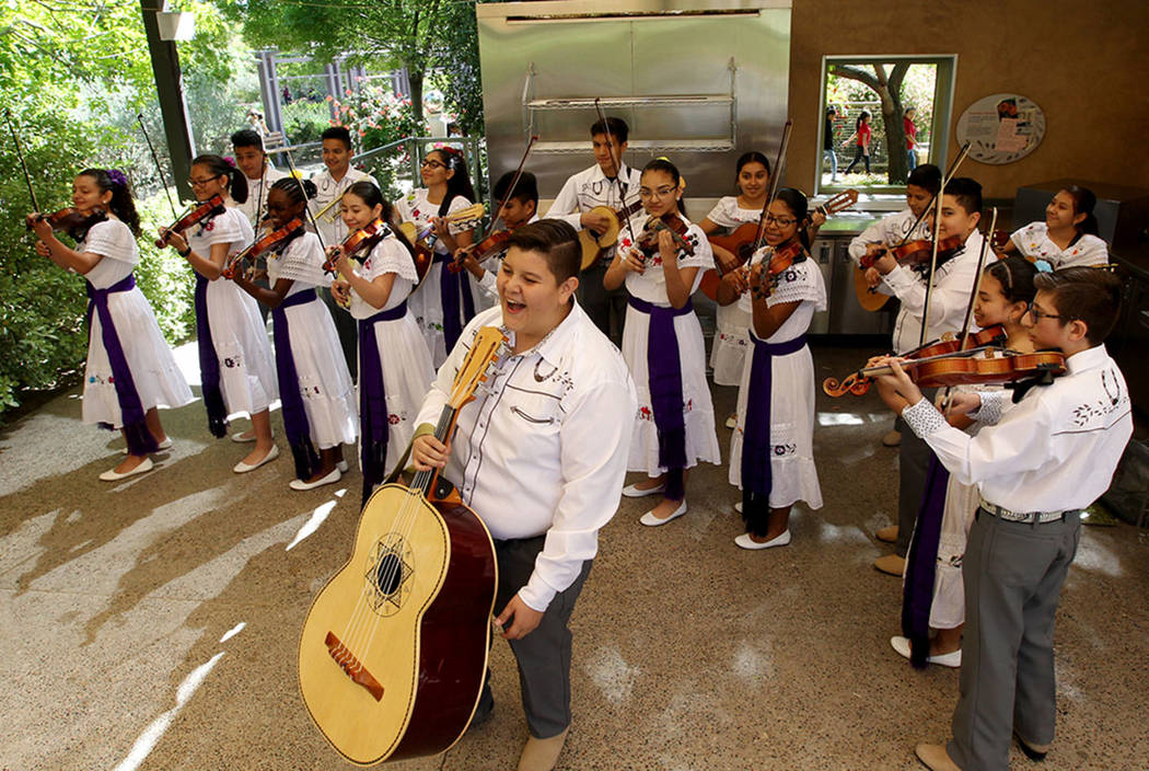 Bridger Middle School Mariachi Band, including eighth-grader Adrian Gonvalev, foreground, perform, Thursday, April 19, 2018, before a news conference to announce plans for the inaugural 1Farm Loca ...
