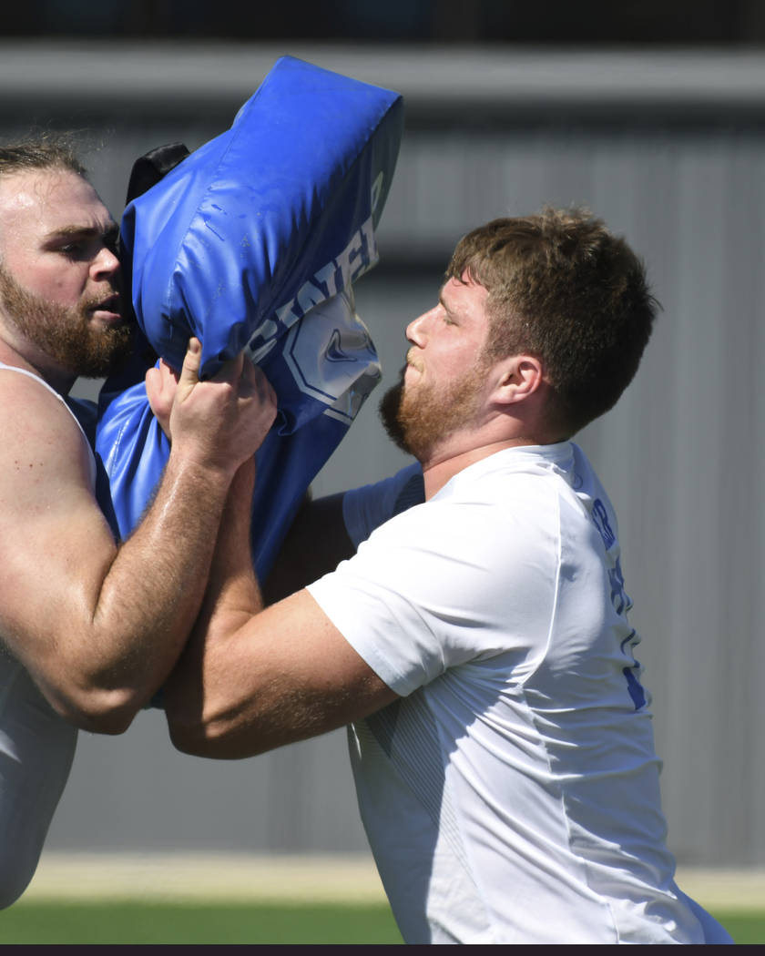 UCLA offensive tackle Kolton Miller, right, participates in a blocking drill during UCLA's pro day for NFL draft prospects in Los Angeles, Thursday, March 15, 2018. (AP Photo/Michael Owen Baker)