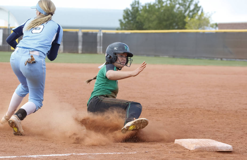 Palo Verde's Makall Whetten slides safely into third base against Centennial's Seanna Simpson during a softball game at Palo Verde High School in Las Vegas on Thursday, April 19, 2018.  Richa ...