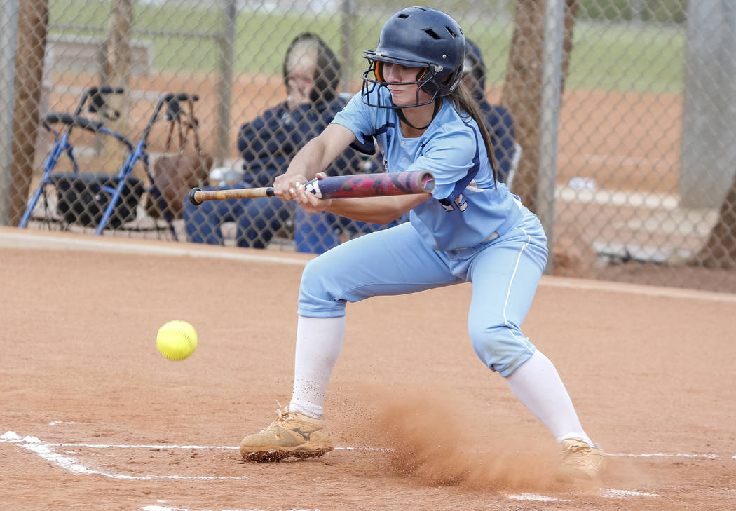Centennial's Abby Hanley bunts the ball during a softball game at at Palo Verde High School in Las Vegas on Thursday, April 19, 2018. Richard Brian Las Vegas Review-Journal @vegasphotograph