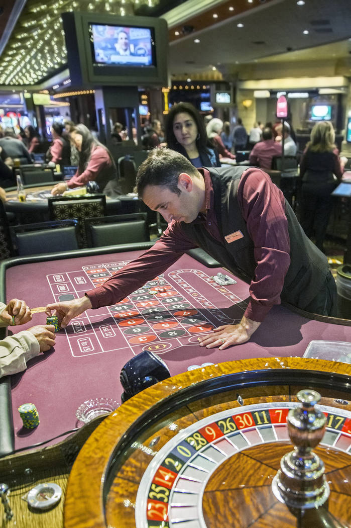 Roulette dealer Derek Hoffman, middle, places bets at the MGM Grand hotel-casino on Thursday, April 19, 2018, in Las Vegas. Benjamin Hager Las Vegas Review-Journal @benjaminhphoto