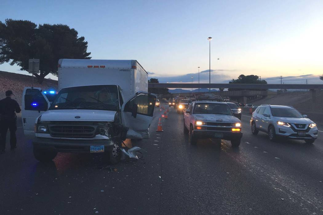 A crash between a semitrailer and a box truck caused a Friday morning traffic jam on Interstate 15 in central Las Vegas. (Twitter/Nevada Highway Patrol)