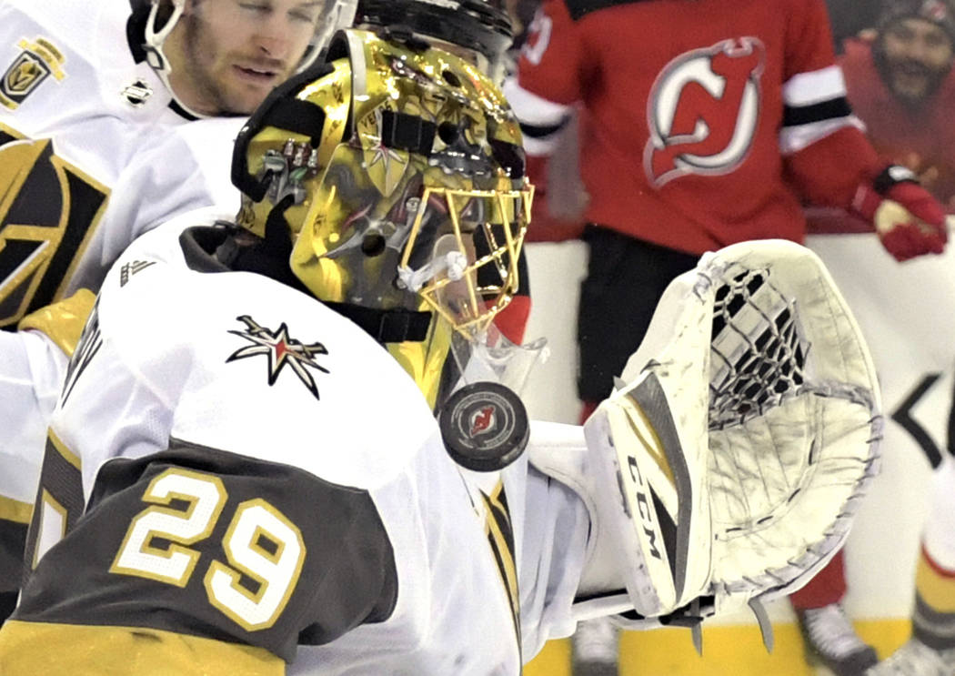 Vegas Golden Knights goaltender Marc-Andre Fleury (29) stops the puck during the second period of an NHL hockey game against the New Jersey Devils, Sunday, March 4, 2018, in Newark, N.J. (AP Photo ...