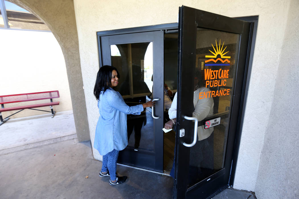 Cozy Harris, left, a mental health technician and behavioral health technician at WestCare nonprofit addiction treatment center at 323 N. Maryland Pkwy. in downtown Las Vegas Friday, April 20, 201 ...