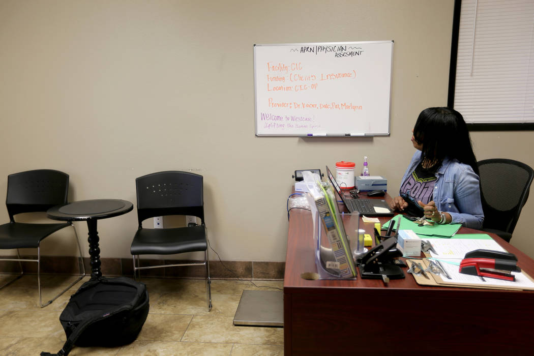 Cozy Harris, a mental health technician and behavioral health technician, in a triage room at WestCare nonprofit addiction treatment center at 323 N. Maryland Pkwy. in downtown Las Vegas Friday, A ...