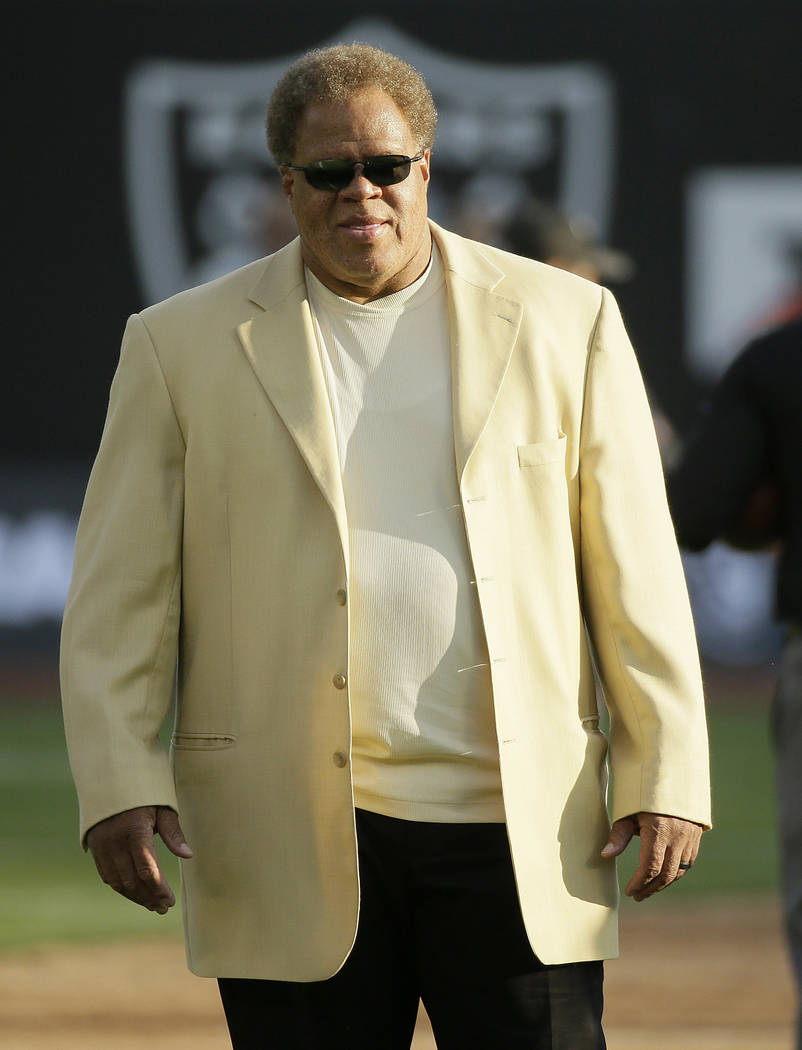 Oakland Raiders general manager Reggie McKenzie walks on the field before an NFL preseason football game between the Raiders and the Seattle Seahawks in Oakland, Calif., Thursday, Aug. 31, 2017. ( ...