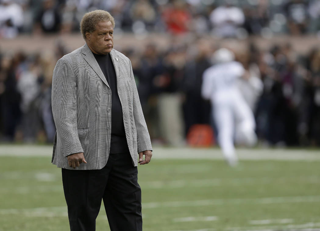 FILE - In this Oct. 19, 2017, file photo, Oakland Raiders general manager Reggie McKenzie stands on the field before the team's NFL football game against the Kansas City Chiefs in Oakland, Calif. ...