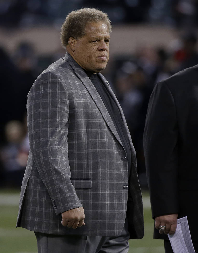 Oakland Raiders general manager Reggie McKenzie stands on the field before an NFL football game against the Dallas Cowboys in Oakland, Calif., Sunday, Dec. 17, 2017. (AP Photo/Eric Risberg)