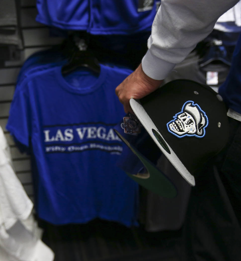 """Jesus Gonzalez holds a hat featuring the special Las Vegas 51s """"Reyes de Plata"""" (Silver Kings) name, part of a new Minor League Baseball initiative, at the team store at Cashman Field in ..."""