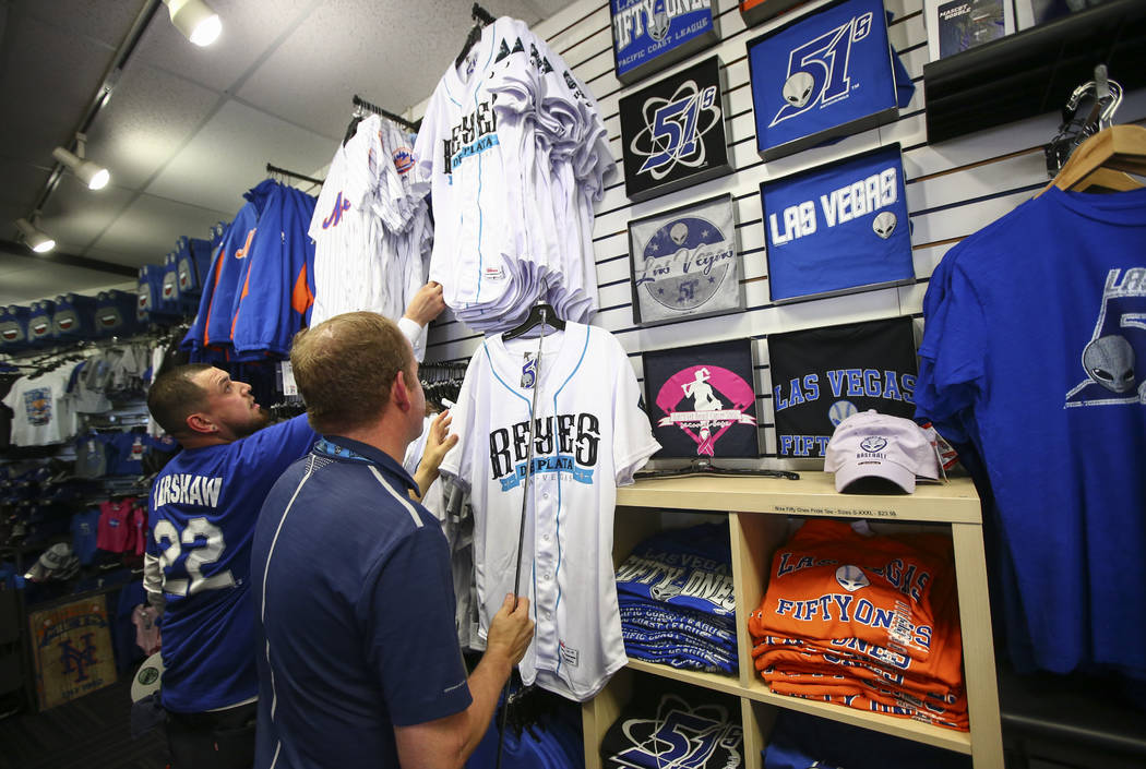 "Jerseys featuring the special Las Vegas 51s ""Reyes de Plata"" (Silver Kings) name, part of a new Minor League Baseball initiative, are displayed at the team store at Cashman Field in Las ..."