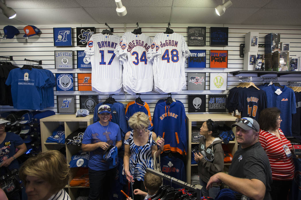 Fans browse team merchandise during the Big League Weekend baseball game between the Chicago Cubs and the New York Mets at Cashman Field on Friday, March 1, 2016, in Las Vegas. The Mets won 8-1. E ...