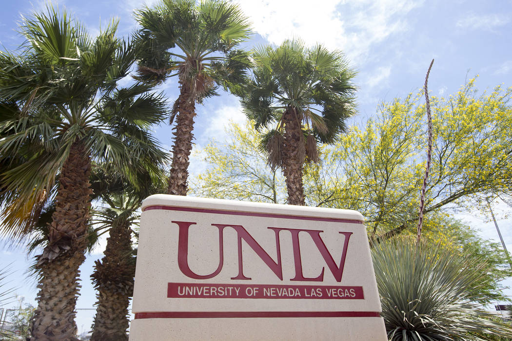 A UNLV sign at the intersection of Harmon Avenue and Swenson Street on Saturday, May 6, 2017, in Las Vegas. UNLV has undertaken an effort to rename Swenson Street to University Parkway or Universi ...