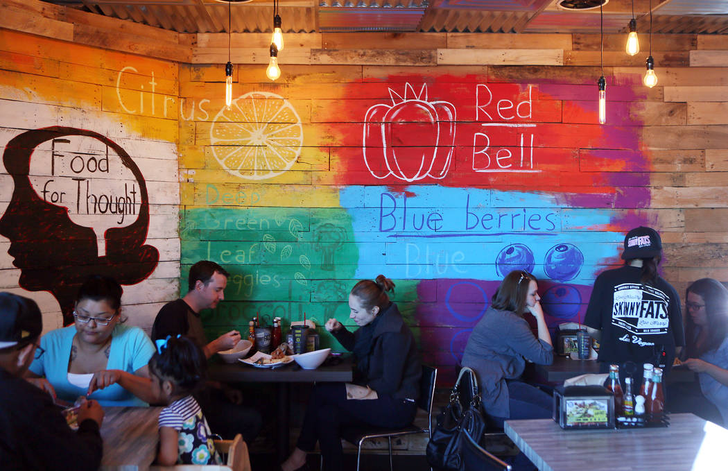 Customers dine at SkinnyFATS Saturday, Dec. 6, 2014, in Las Vegas. SkinnyFATS, located at 6261 Dean Martin Drive, features a split menu that has both healthy and indulgent menu items. (Ronda Churc ...