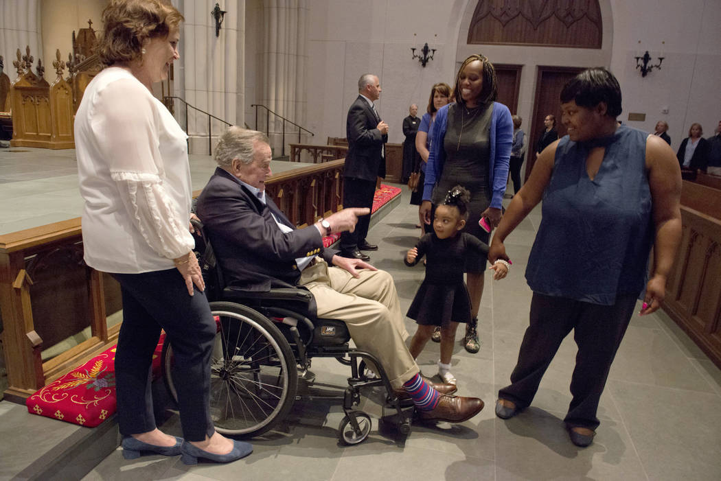 """Former President George H. W. Bush greets the mourners with his daughter Dorothy """"Doro"""" Bush Koch during the visitation for former first lady Barbara Bush at St. Martin's Episcopal Churc ..."""