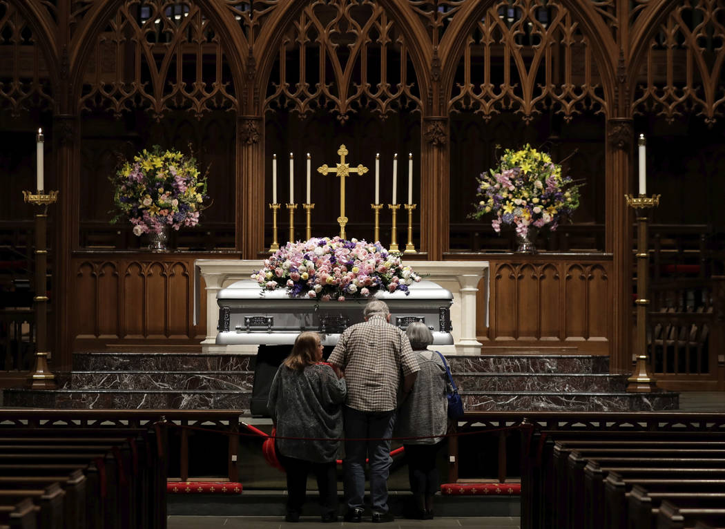 Mourners pause as former U.S. first lady Barbara Bush lies in repose during the visitation of former first lady Barbara Bush at St. Martin's Episcopal Church, Friday, April 20, 2018, in Houston. ( ...