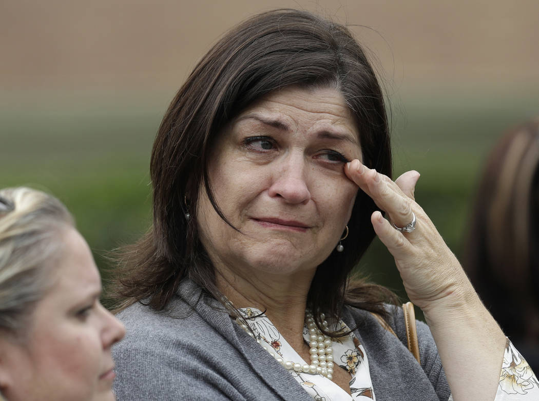 Rebecca Halaska, right wipes tears as she leaves the visitation of former first lady Barbara Bush St. Martin's Episcopal Church Friday, April 20, 2018, in Houston. Barbara Bush died on April 17, a ...