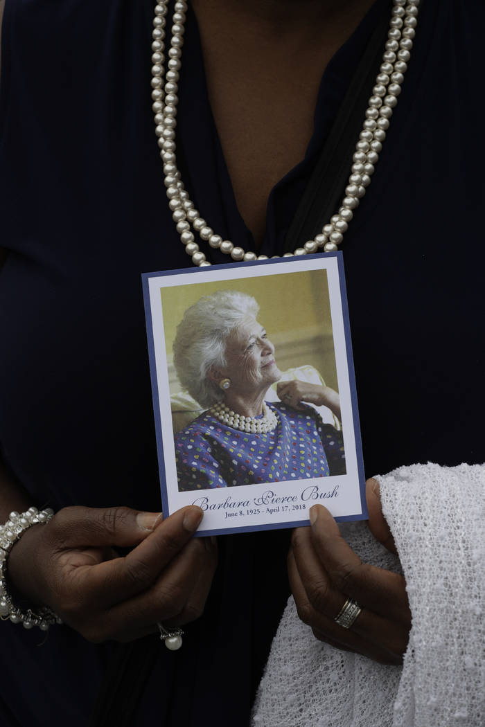 Dorothy Hanson holds the program as she leaves the visitation of former first lady Barbara Bush at St. Martin's Episcopal Church Friday, April 20, 2018, in Houston. Barbara Bush died on April 17, ...