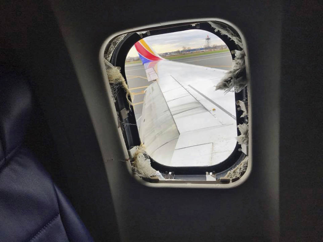 This April 17, 2018 photo provided by Marty Martinez shows the window that was shattered after a jet engine of a Southwest Airlines airplane blew out at altitude, resulting in the death of a woman ...