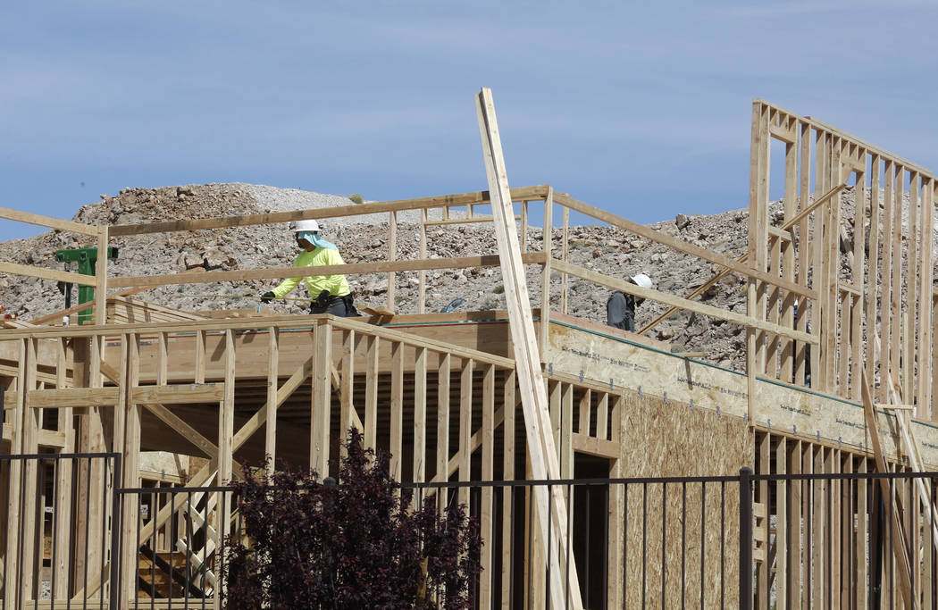 Construction workers put up new homes at the Cove at Southern Highlands and St. Rose parkways on Wednesday, April 18, 2018, in Las Vegas. Bizuayehu Tesfaye/Las Vegas Review-Journal @bizutesfaye