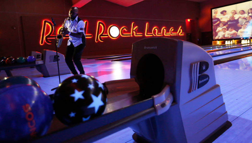 Jazz musician Mike Phillips performs during the Ogden Celebrity Bowl at Red Rock Lanes in Las Vegas, Sunday, April 22, 2018. ProFootballHallofFamemember Jonathan Ogden, his wife Kema and ...