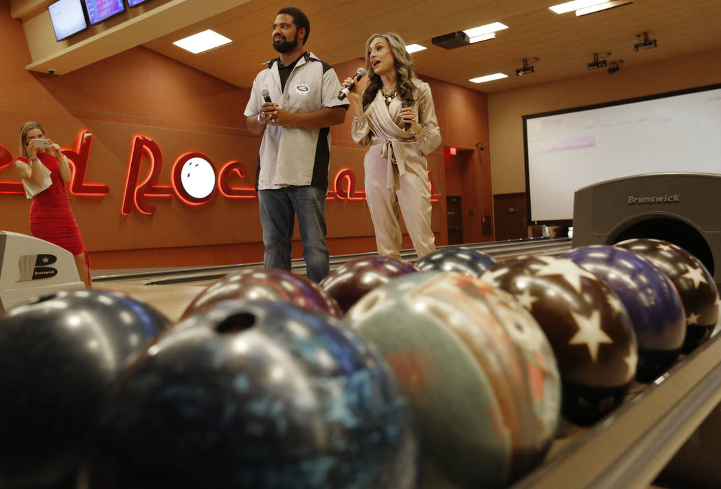 Pro Football Hall of Fame member Jonathan Ogden and his wife Kema speak during the Ogden Celebrity Bowl at Red Rock Lanes in Las Vegas, Sunday, April 22, 2018. Ogden and his friends come toge ...