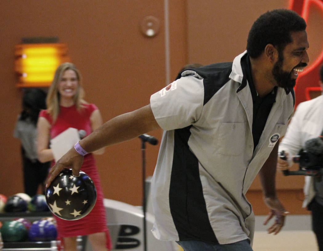 Pro Football Hall of Fame member Jonathan Ogden makes a shot during the Ogden Celebrity Bowl at Red Rock Lanes in Las Vegas, Sunday, April 22, 2018. Ogden and his friends come together on Sun ...