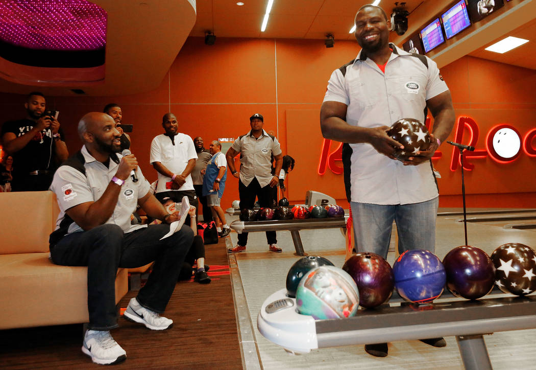 Hasim Rahman, former boxing champion, right, goes bowling as Ephraim Salaam, former NFL player, looks on during the Ogden Celebrity Bowl at Red Rock Lanes in Las Vegas, Sunday, April 22, 2018. Pro ...