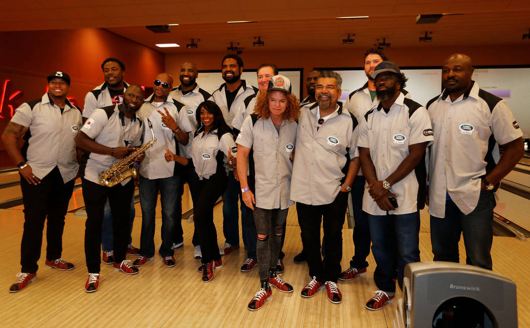 Pro Football Hall of Fame member Jonathan Ogden back row, fourth from left, and his celebrity friends pose for a photo during the Ogden Celebrity Bowl at Red Rock Lanes in Las Vegas, Sunday, ...