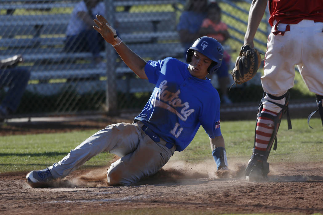 Green Valley's Josh George (11) slides home for a score against Liberty during the seventh inning of the baseball game at Liberty High School in Henderson, Friday, April 20, 2018. Green Valley won ...