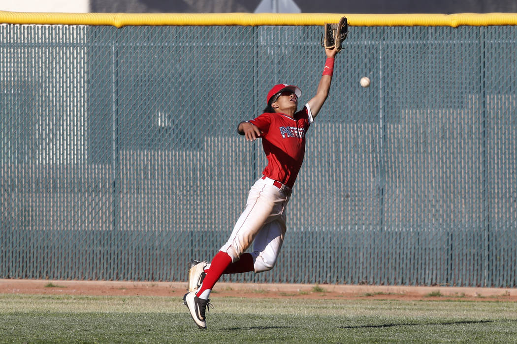 Liberty's Mason Bowden (1) misses the ball in the outfield against Green Vally during the seventh inning of the baseball game at Liberty High School in Henderson, Friday, April 20, 2018. Green Val ...